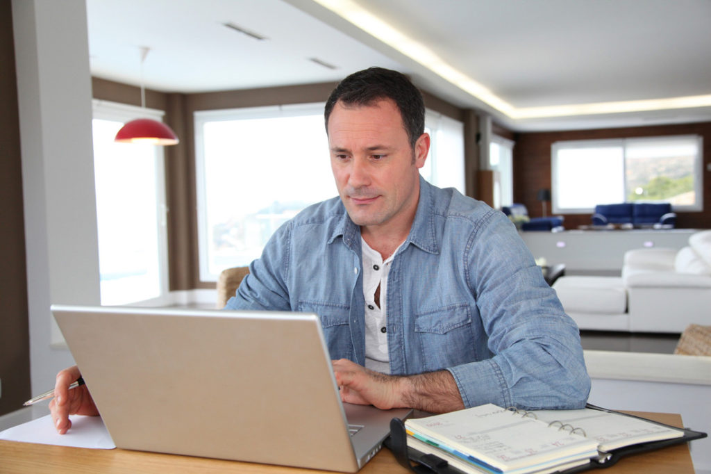RS111_bigstock-Man-working-at-home-on-laptop--17009636-scr